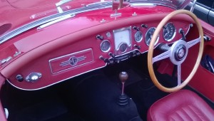 The Twin cam has a fabric covered facia to match the interior trim and a chrome bezel around the radio speaker.